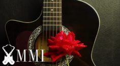 Escuchar música romántica con guitarra como principal instrumento.
